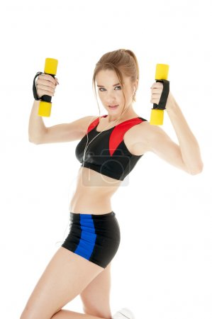 Athletic girl with dumbbells covering white background