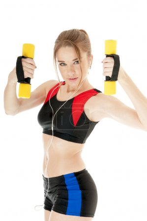 Sports girl  exercising with dumbbells on white background