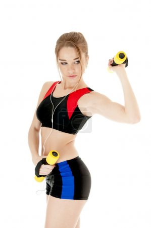 Sports girl  exercising with dumbbells on white background
