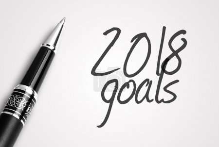 pen writes 2018 goals on paper