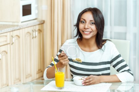 Portrait of woman eating cereals.