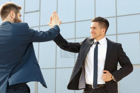 Two  business colleagues high-fiving