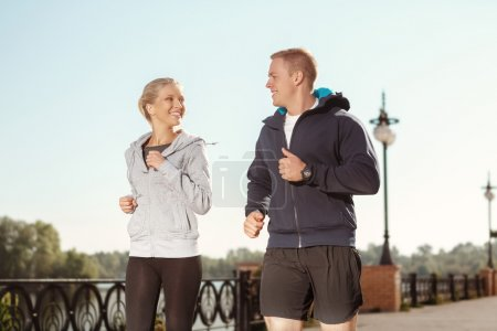 Photo for Happy young friends enjoying a run outdoors - Royalty Free Image