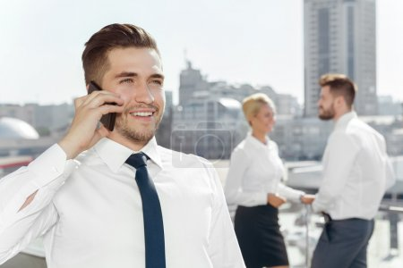 Successful businessman talking on his phone