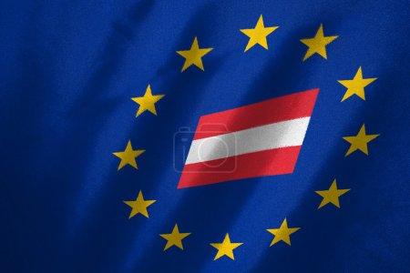 Photo pour Drapeau de l'Autriche dans le drapeau de l'UE sur le tissu - image libre de droit