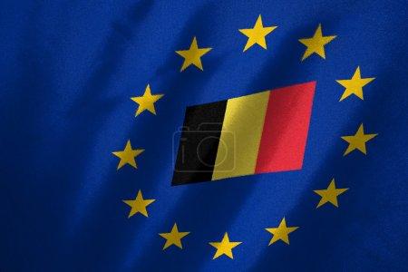 Photo pour Drapeau belge dans le drapeau de l'UE sur le tissu - image libre de droit