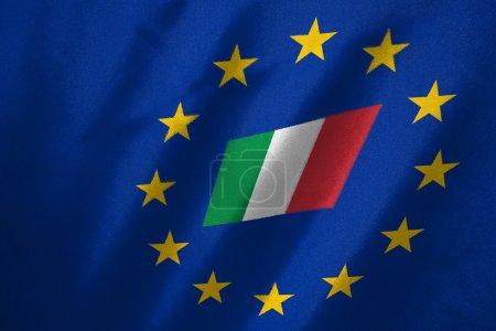 Photo pour Drapeau italien dans le drapeau de l'UE sur le tissu - image libre de droit