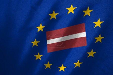 Photo pour Drapeau Lettonie en drapeau de l'UE sur tissu - image libre de droit