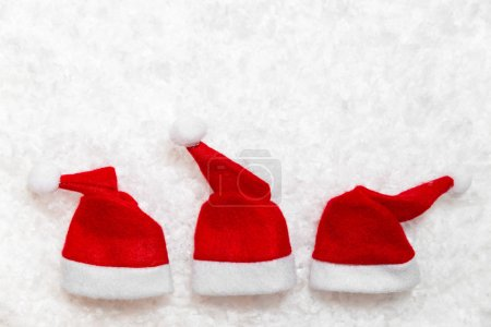 Three red santa claus hats