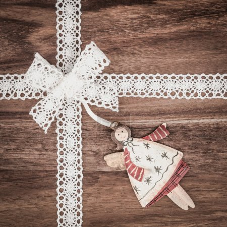 Photo for Christmas angel and ribbon on wood, holiday background - Royalty Free Image