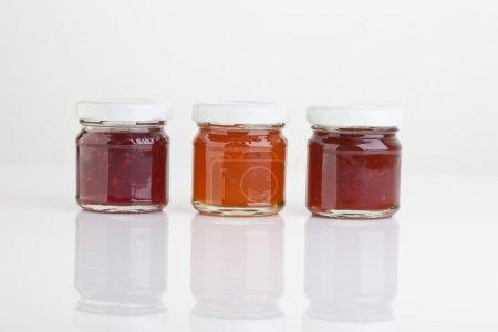 Variety of jam on white background,close up