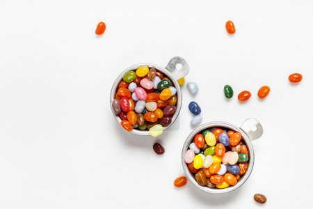 Jelly beans, bowls, white background
