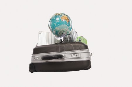 Suitcases and luggages with globe against white background