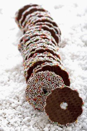 Chocolate fondant rings on icing sugar
