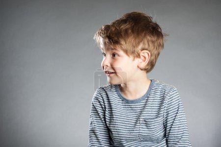 Portrait of boy, emotion, amazed, grey background