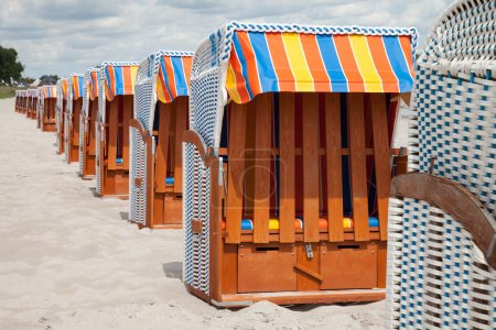 Germany, Schleswig-Holstein, Baltic Sea, closed beach chairs at