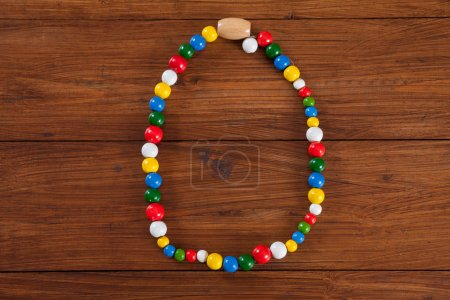 Colorful chain on wood, copy space