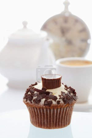Close up of buttercream cupcake with chocolate crumble and choco