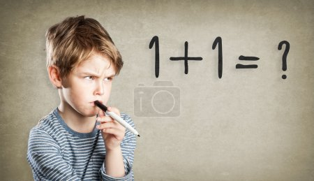 Boy, writing and thinking, trouble with math