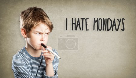 Boy on grunge background, I hate mondays