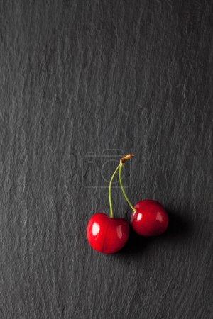 Sweet cherries on slate