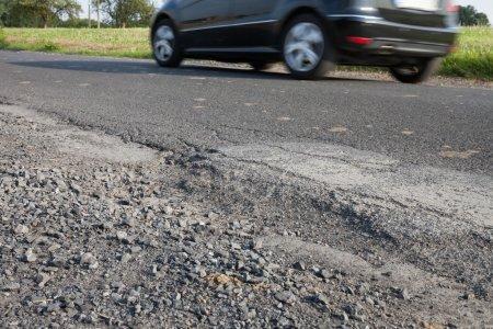 Germany, car on road, apshalt, pothole