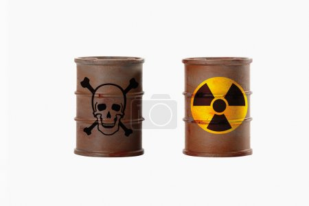 Barrels with signs of skull and crossbones and radioactivity on