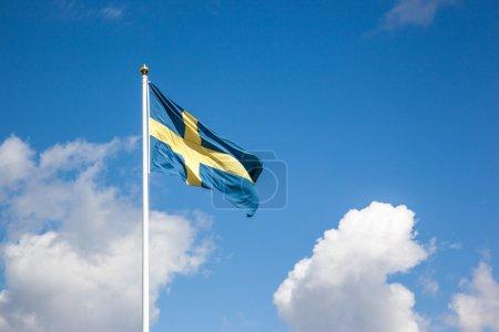Flag of Sweden, cloudy sky