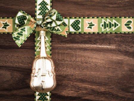 Christmas, gift ribbon on wood, christmas decoration, cello