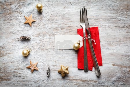 Christmas still life, cutlery and decoration on wood