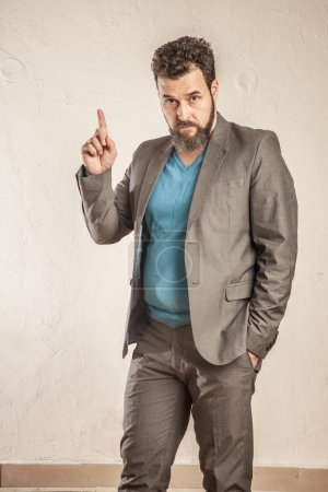 Business man with beard raising finger