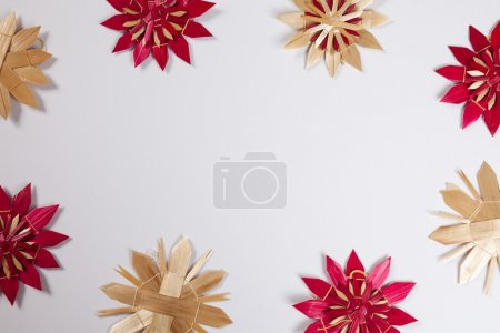 Straw stars, white background, copy space