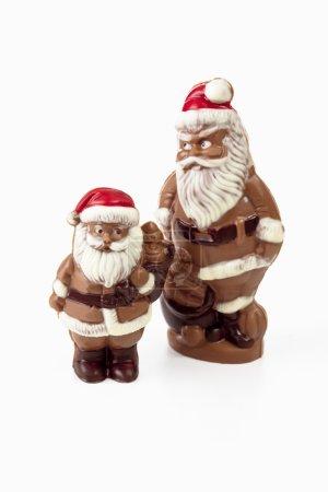 Two chocolate santa figurines