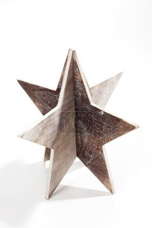 Photo for Silver partial star shaped christmas decoration on white background - Royalty Free Image