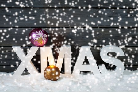 Capital letters forming the word xmas