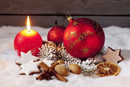 Photo for Traditional Christmas decorations on pile of snow - Royalty Free Image