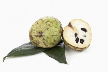 Whole and half cherimoyas