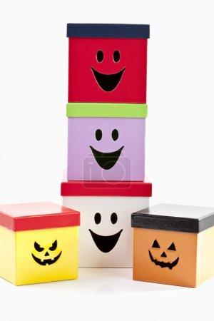 Colored boxes with funny faces on white background