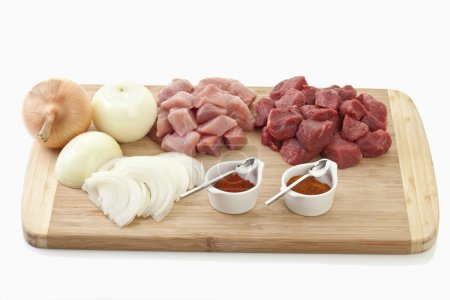 Ingredients for goulash on chopping board