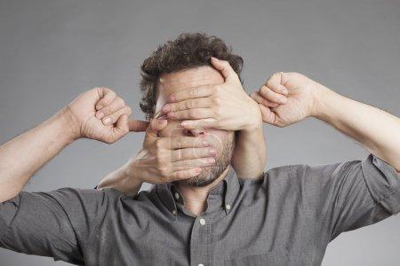 Man not seeing not hearing not saying anything