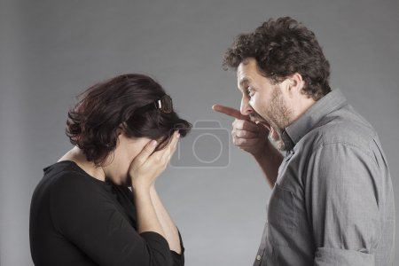 Mature couple quarreling man shouting woman crying