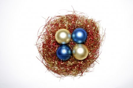 Easter nest, tinsel, Christmas baubles, elevated view