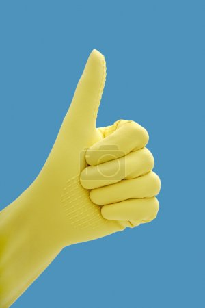 Hand in rubber gloves gesturing okay, close up