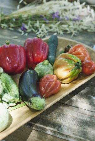 Italy, Tuscany, Magliano, Close up of various vegetables in wood tray