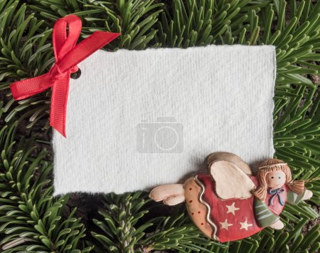 Photo for Christmas, angel, blank paper on evergreens on wooden background - Royalty Free Image