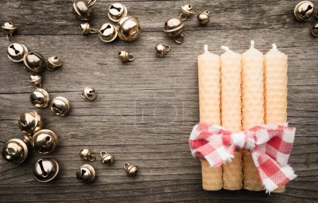 candles and bells on wood