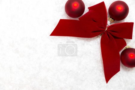Red baubles, ribbon, copy space,