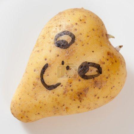 Heart shaped potato with happy face