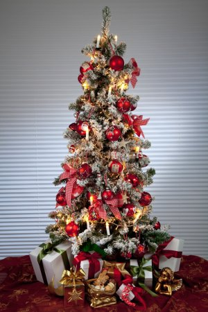 Photo for Decorated christmas tree with electric candles and presents - Royalty Free Image