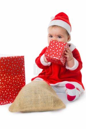 Little girl dressed as Santa